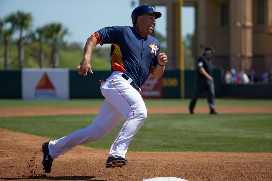 Matt Dominguez rounds third base. Photo: Rob Foldy, Getty Images