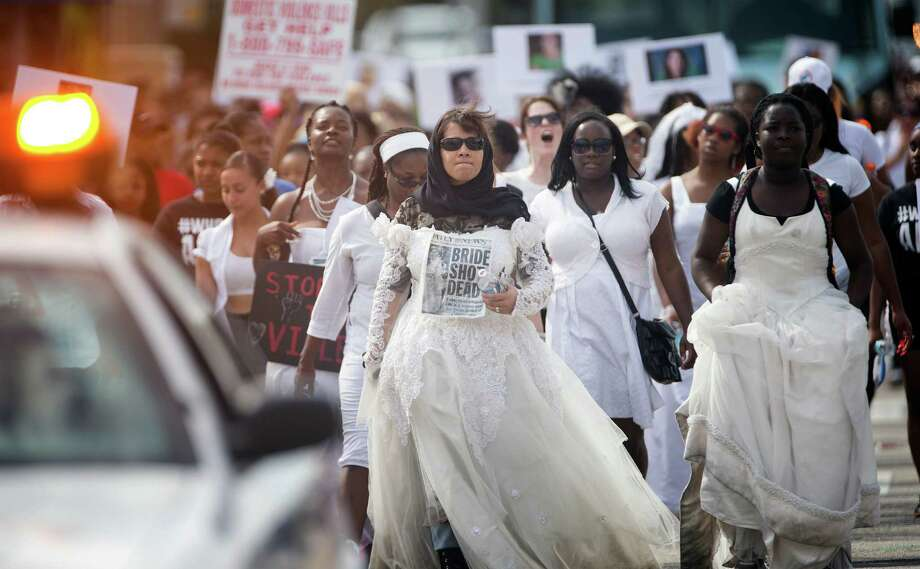 "A group of students stage a protest walk against domestic violence last year in Miami.  Barry University hosted its third annual ""Brides Walk,"" an event to raise awareness about domestic and dating violence among college and high school students, Women in wedding gowns made the six-mile walk. Photo: J Pat Carter, Associated Press / AP"