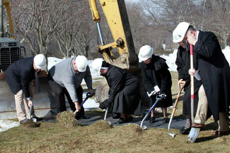 Putting on their hard hats , from left, Kevin Solli,Tom Augustino, Mother Jana Zawieja, Sister Barbara Jean Wojnicki, Sister Teresa Mika, and John Kimball, dig in for the groundbreaking of the new convent in Monroe, Conn. on Sunday March 9, 2014. Photo: BK Angeletti, B.K. Angeletti / Connecticut Post freelance B.K. Angeletti