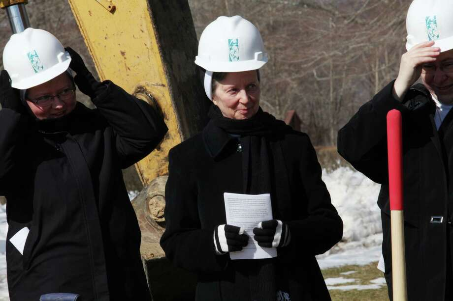 Putting on their hard hats , from left,  Mother Jana Zawieja, Sister Barbara Jean Wojnicki, and Sister Teresa Mika, prepare to dig for the groundbreaking of the new convent in Monroe, Conn. on Sunday March 9, 2014. Photo: BK Angeletti, B.K. Angeletti / Connecticut Post freelance B.K. Angeletti