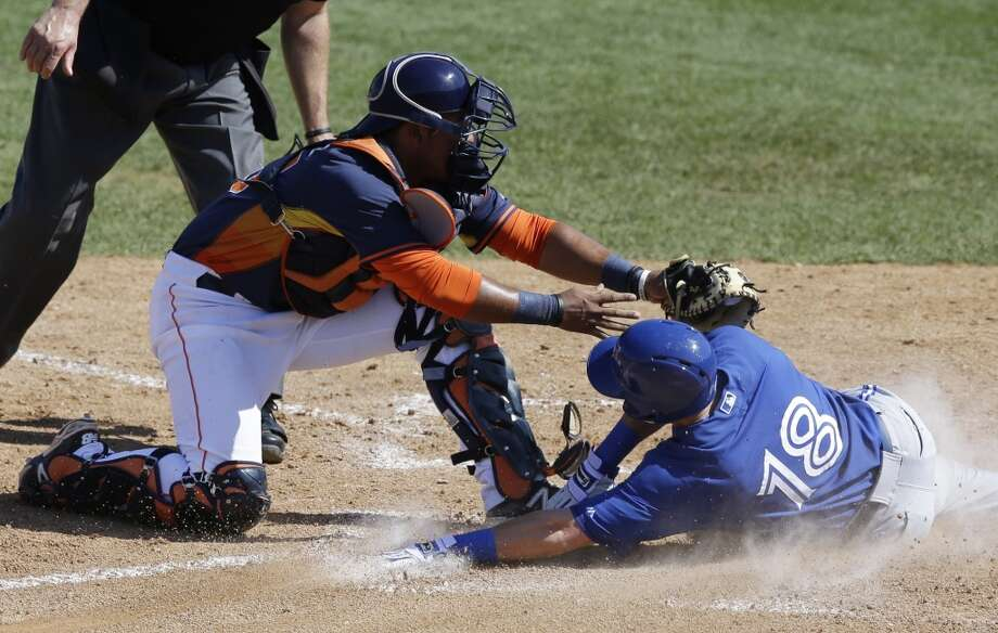 Ryan Langerhans, right, slides under the tag of Astros catcher Carlos Perez during the eighth inning. Photo: Carlos Osorio, Associated Press