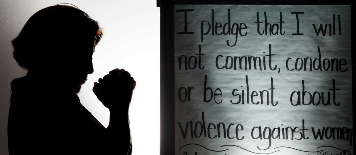 A domestic violence victim who wish not to be identify is silhouetted at The bridge over troubled waters' shelter on Monday, Jan. 27, 2014, in Pasadena. ( J. Patric Schneider / For the Chronicle )