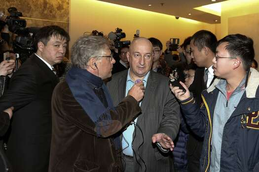 Hugh Dunleavy, (Center) Head of commercial - Malaysia Airlines speaks to media at Lido Hotel as the search continues for the missing Malaysian airliner on March 9, 2014 in Beijing, China. Malaysia Airline Flight MH370 from Kuala Lumpur to Beijing and carrying 239 onboard was reported missing on early on March 8 after the crew failed to check in as scheduled while flying over the sea between Malaysia and Ho Chi Minh City in Vietnam. Photo: Lintao Zhang, Getty Images