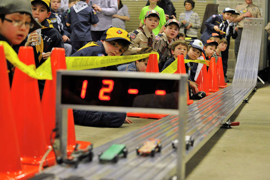 Greenwich Cub Scouts watch as cars cross the finish line during the Greenwich Boy Scouts of America Council's Pinewood Derby Championships at the Greenwich Public Safety Complex in Greenwich, Conn., on Sunday March 9, 2014. Photo: Jason Rearick / Stamford Advocate