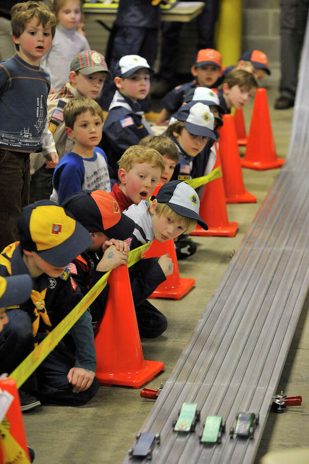 Greenwich Cub Scouts watch and react as cars cross the finish line during the Greenwich Boy Scouts of America Council's Pinewood Derby Championships at the Greenwich Public Safety Complex in Greenwich, Conn., on Sunday March 9, 2014. Photo: Jason Rearick / Stamford Advocate