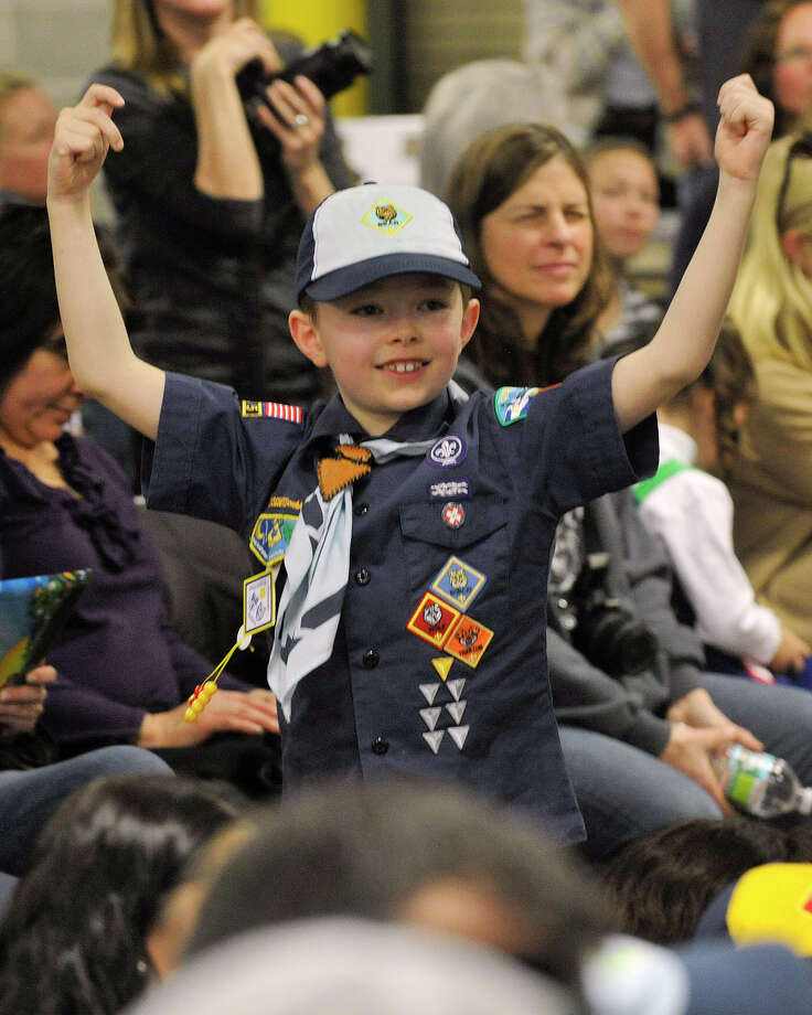 Ethan Miklautsch, from Pack 23, celebrates his heat victory during the Greenwich Boy Scouts of America Council's Pinewood Derby Championships at the Greenwich Public Safety Complex in Greenwich, Conn., on Sunday March 9, 2014. Photo: Jason Rearick / Stamford Advocate