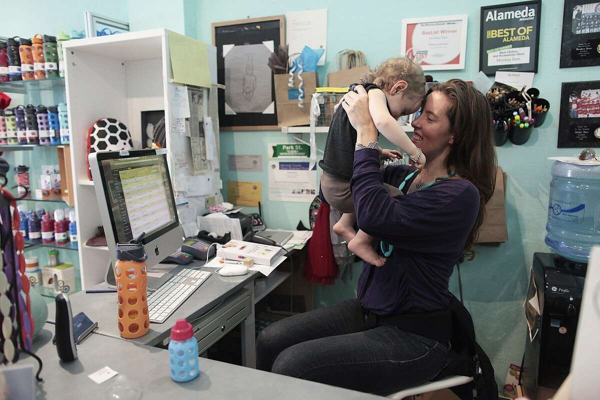 Heather Rider plays with her son Colin at her store, Monkey Bars, in Alameda, Calif. on Thursday, March 6, 2014. New research shows that items with low doses of BPA are more safe than BPA-free items.