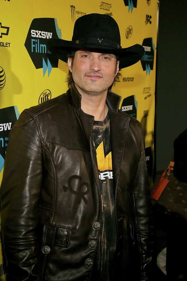 Director Robert Rodriguez poses on the red carpet for the 'From Dusk Till Dawn: The Series'  premiere March 8, 2014, at the South By Southwest Film Festival  in Austin, Texas. Photo: Gary Miller, Getty Images / 2014 Gary Miller