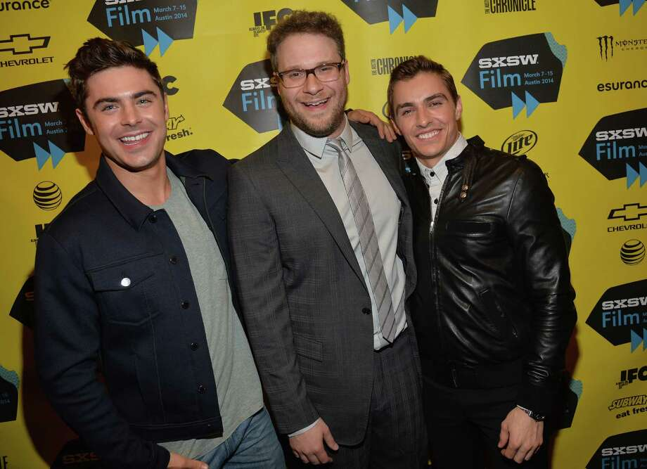 "AUSTIN, TX - MARCH 08:  (L-R) Actor Zac Efron, actor Seth Rogan and actor Dave Franco pose for pictures in the green room at the premiere of ""Neighbors"" during the 2014 SXSW Music, Film + Interactive Festival  at the Paramount Theatre on March 8, 2014 in Austin, Texas. Photo: Michael Buckner, Getty Images / 2014 Getty Images"