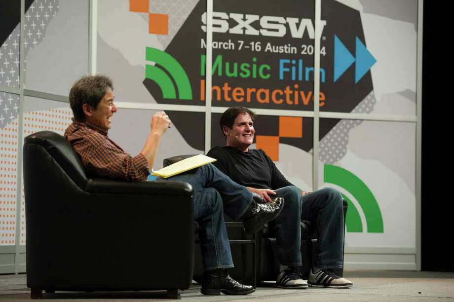 Guy Kawasaki, chairman and chief executive officer of Garage.com and co-founder of Alltop.com, left, listens as Mark Cuban, billionaire owner of the NBA Dallas Mavericks basketball team, speaks during a panel discussion at the South By Southwest (SXSW) Interactive Festival in Austin, Texas, U.S., on Saturday, March 8, 2014. The SXSW conferences and festivals converge original music, independent films, and emerging technologies while fostering creative and professional growth. Photographer: David Paul Morris/Bloomberg *** Local Caption *** Mark Cuban; Guy Kawasaki Photo: David Paul Morris, Getty Images / © 2014 Bloomberg Finance LP