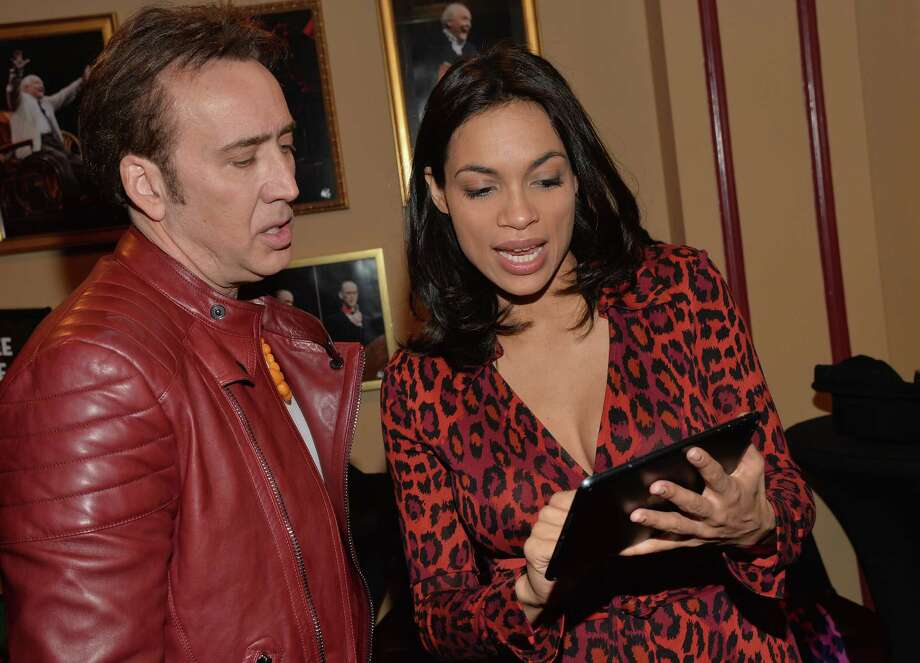 "AUSTIN, TX - MARCH 09:  Actor Nicholas Cage (L) and actress Rosario Dawson pose for photos in the green room for the premiere of ""Joe"" during the 2014 SXSW Music, Film + Interactive Festival at Paramount Theatre on March 9, 2014 in Austin, Texas. Photo: Michael Buckner, Getty Images / 2014 Getty Images"
