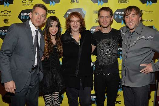 "AUSTIN, TX - MARCH 09:  (L-R) Actor Ethan Hawke, actress Lorelei Linklater, Janet Pierson, SXSW Film Festival Director, actor Ellar Coltrane and director Richard Linklater arrive at the premiere of ""Boyhood"" at the 2014 SXSW Music, Film + Interactive Festival  at the Paramount Theatre on March 9, 2014 in Austin, Texas. Photo: Michael Buckner, Getty Images / 2014 Getty Images"