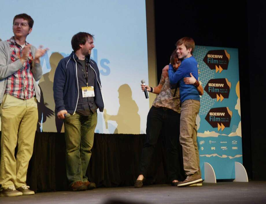 "AUSTIN, TX - MARCH 09:  Filmmaker Kat Candler (2nd R) and actor Josh Wiggins (R) take part in a Q&A following the ""Hellion"" premiere during the 2014 SXSW Music, Film + Interactive Festival at the Topfer Theatre at ZACH on March 9, 2014 in Austin, Texas. Photo: Michael Loccisano, Getty Images / 2014 Getty Images"