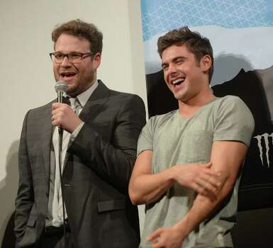"AUSTIN, TX - MARCH 08:  Actor Seth Rogan (L) and actor Zac Efron speak on stage at the premiere of ""Neighbors"" during the 2014 SXSW Music, Film + Interactive Festival  at the Paramount Theatre on March 8, 2014 in Austin, Texas. Photo: Michael Buckner, Getty Images / 2014 Getty Images"