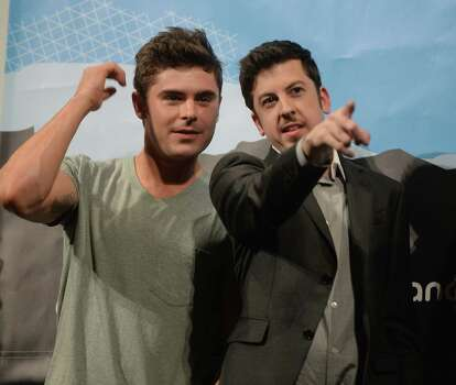 "AUSTIN, TX - MARCH 08:  Actor Zac Efron (L) and actor Christopher Mintz-Plasse speak on stage at the premiere of ""Neighbors"" during the 2014 SXSW Music, Film + Interactive Festival  at the Paramount Theatre on March 8, 2014 in Austin, Texas. Photo: Michael Buckner, Getty Images / 2014 Getty Images"