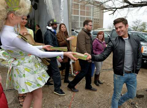 IMAGE DISTRIBUTED FOR SUBWAY RESTAURANTS - A SUBWAY model hands Zac Efron the brand's new Flatizza product following a Tumblr Q&A event at SXSUBWAY square in Austin, Texas on Sunday, March 9, 2014.  (Photo by Jack Dempsey/Invision for SUBWAY Restaurants/AP Images) Photo: Jack Dempsey, Getty Images / Invision