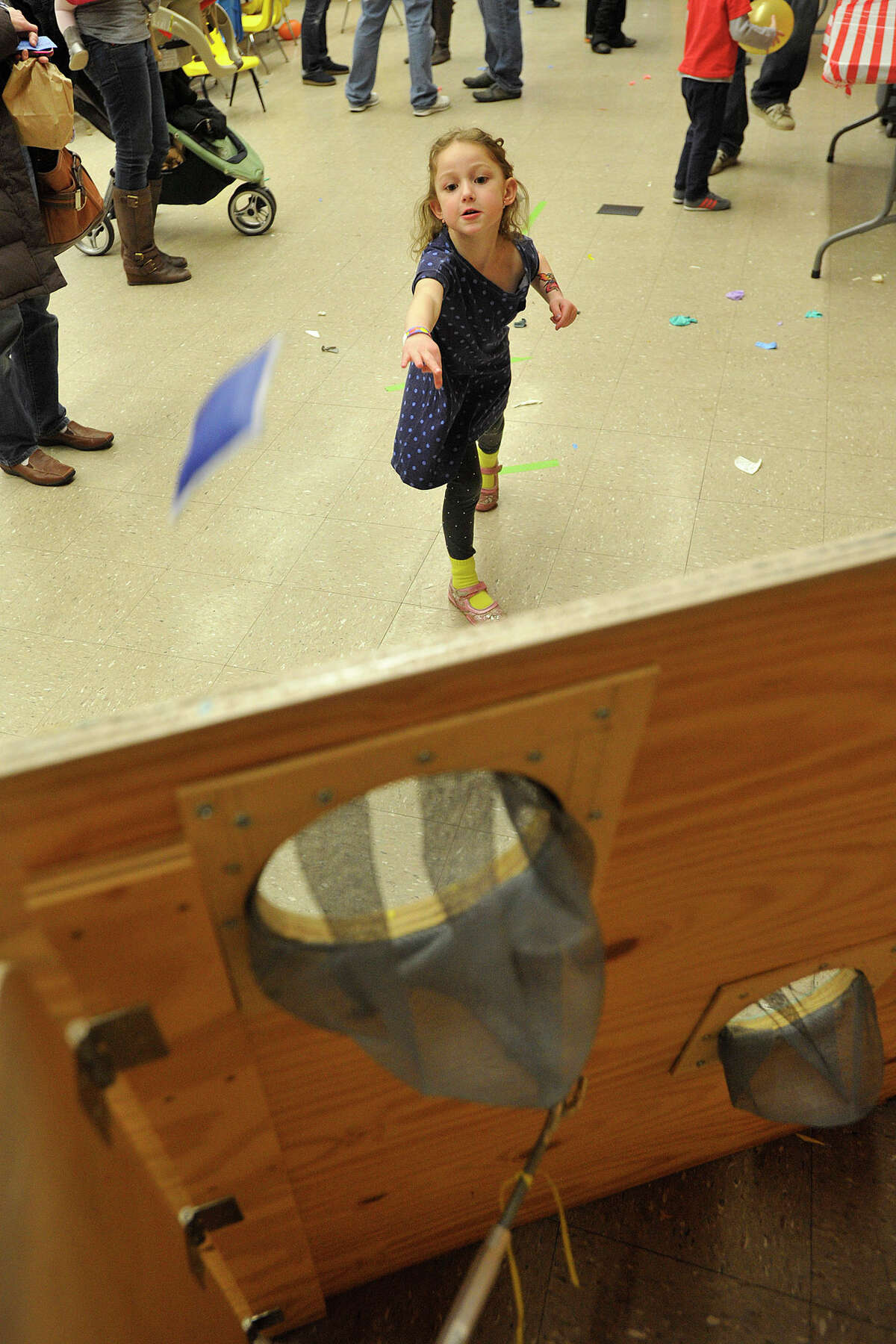 Rebecca Bear throws a bean bag at the bean bag toss station during the 22nd annual JCC Purim Carnival: Under the Big Top at the Jewish Community Center in Stamford, Conn., on Sunday, March 9, 2014.