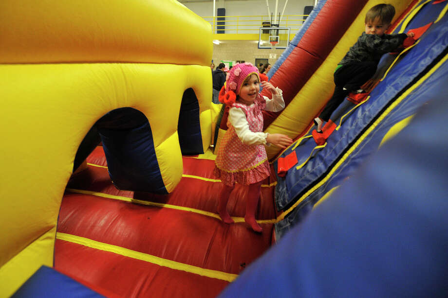 Sadie Palker runs through a bouncy obstacle course during the 22nd annual JCC Purim Carnival: Under the Big Top at the Jewish Community Center in Stamford, Conn., on Sunday, March 9, 2014. Photo: Jason Rearick / Stamford Advocate