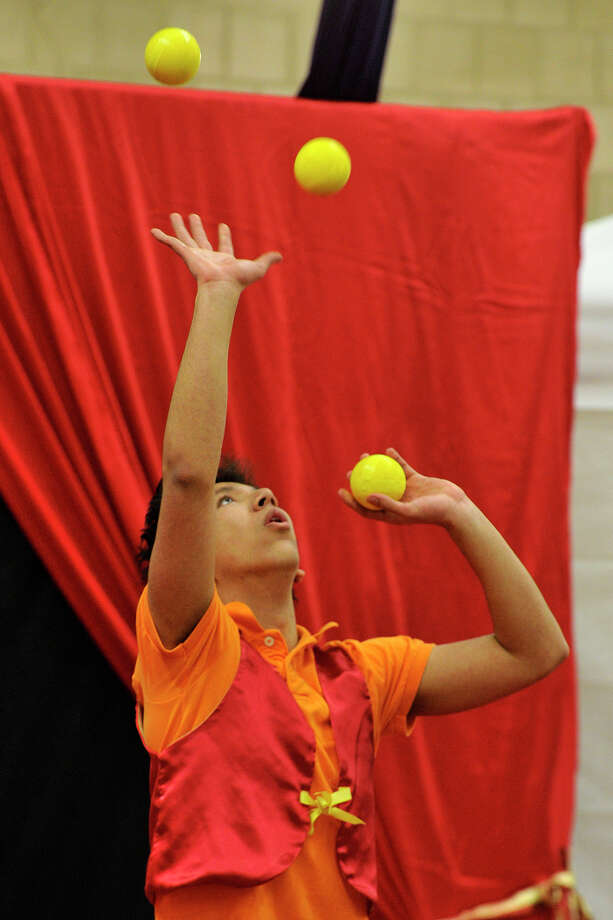 Bryan Guzman, with Westchester Circus Arts Center, performs a juggling routine during the 22nd annual JCC Purim Carnival: Under the Big Top at the Jewish Community Center in Stamford, Conn., on Sunday, March 9, 2014. Photo: Jason Rearick / Stamford Advocate