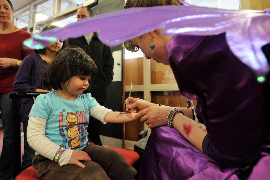 Dorothy Brie gets a fairy painted on her arm by Holly Larkin during the 22nd annual JCC Purim Carnival: Under the Big Top at the Jewish Community Center in Stamford, Conn., on Sunday, March 9, 2014. Photo: Jason Rearick / Stamford Advocate