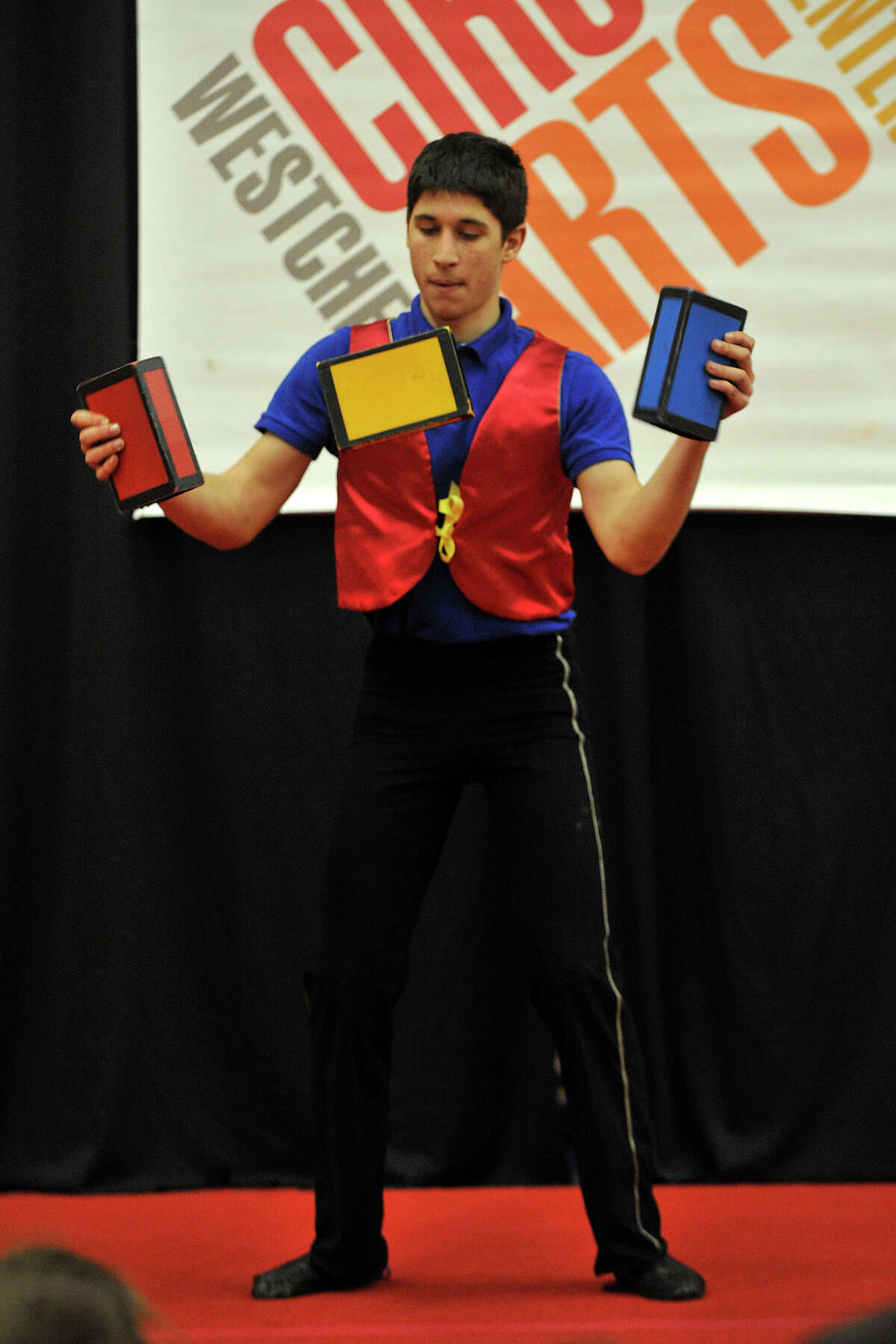 Jonathan Blau, with Westchester Circus Arts Center, performs a juggling routine during the 22nd annual JCC Purim Carnival: Under the Big Top at the Jewish Community Center in Stamford, Conn., on Sunday, March 9, 2014.