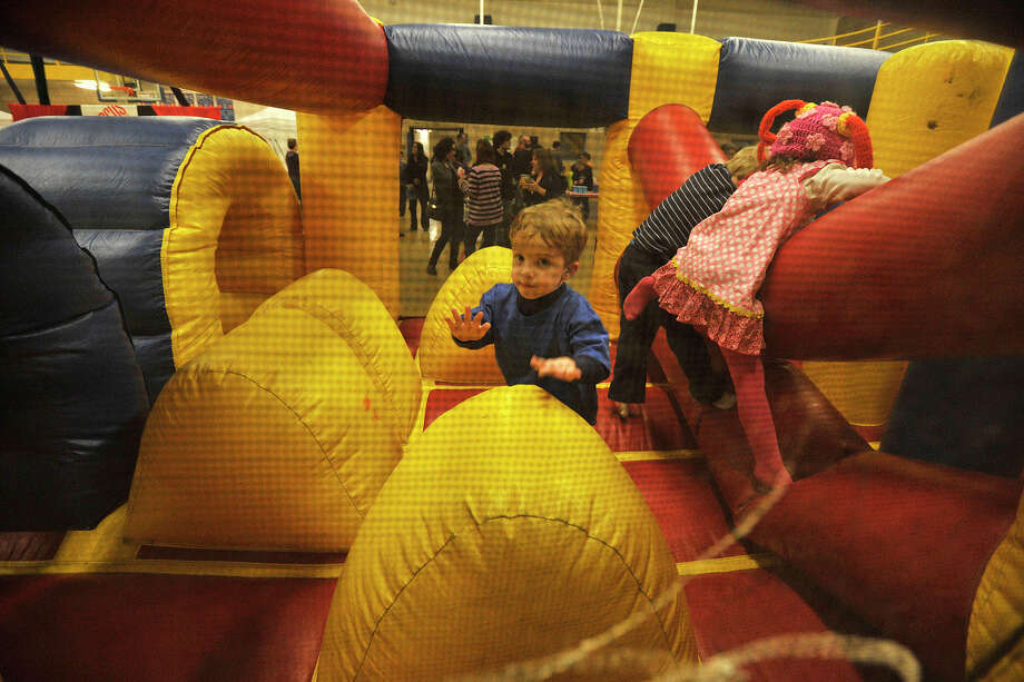 Aaron Palker navigates the bouncy obstacle course during the 22nd annual JCC Purim Carnival: Under the Big Top at the Jewish Community Center in Stamford, Conn., on Sunday, March 9, 2014. Photo: Jason Rearick / Stamford Advocate
