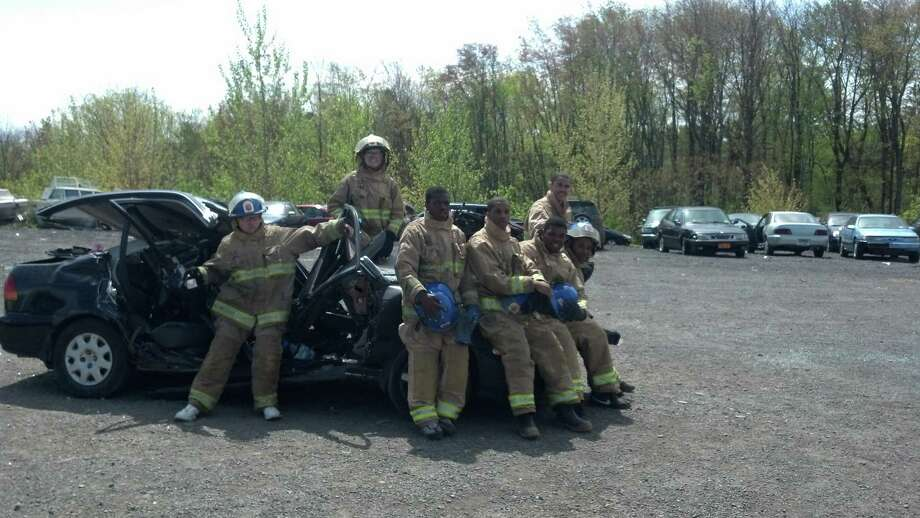 Members of Albany Fire Department Explorer Post pose after a recent vehicle extrication drill. The post run by AFD volunteers gives high school students the chance to learn about a career in the fire service. In this drill, they simulated a vehicle accident with entrapped patient and worked with AFD members with the Jaws of Life to free the patient.   (Brian Wolfgang)