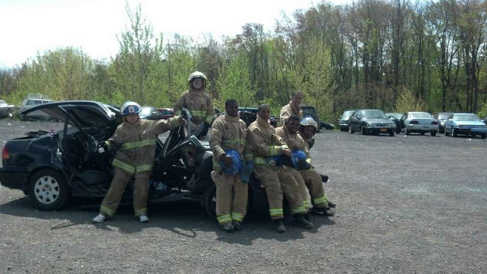 Members of Albany Fire Department Explorer Post pose after a recent vehicle extrication drill. The p