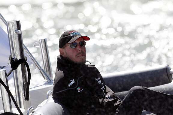 Oracle CEO Larry Ellison sits in his chase boat after Oracle Team USA defeated Emirates Team New Zealand in Race 17 of the America's Cup Finals on Tuesday, September 24, 2013 in San Francisco, Calif.