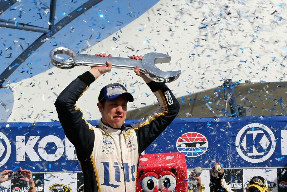 Brad Keselowski hoists the Vegas trophy after wrenching the win away from Dale Earnhardt Jr. Photo: Jerry Markland, Getty Images