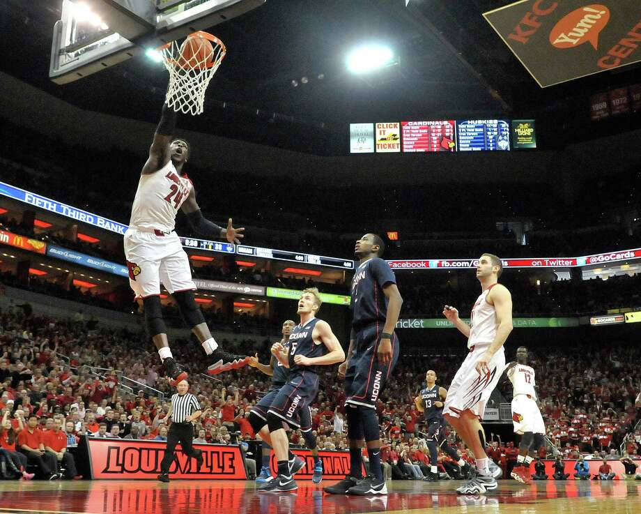 Louisville's Montrezl Harrell, left, dunks for two of his game high 20 points during the second half of an NCAA college basketball game, Saturday, March 8, 2014, in Louisville, Ky. Louisville defeated UConn 81-48. Photo: Timothy D. Easley, AP / Associated Press