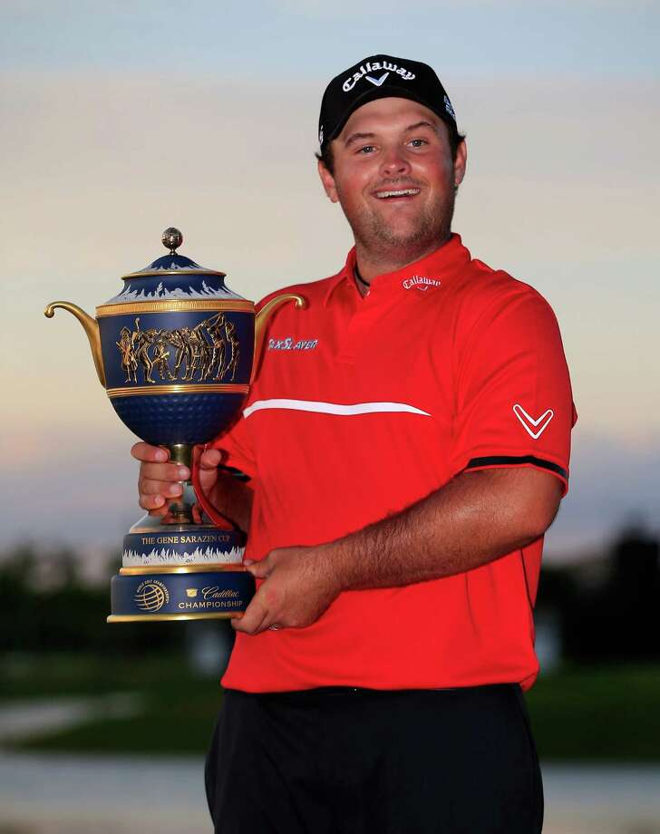 DORAL, FL - MARCH 09:  Patrick Reed celebrates with the Gene Sarazen Cup after his one-stroke victory during the final round of the World Golf Championships-Cadillac Championship at Trump National Doral on March 9, 2014 in Doral, Florida.  (Photo by Jamie Squire/Getty Images) ORG XMIT: 458841871 Photo: Jamie Squire / 2014 Getty Images