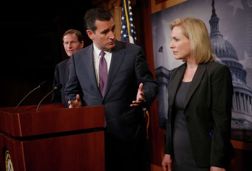 Sen. Ted Cruz, R-Texas, center, talks with Sen. Kirsten Gillibrand, D-N.Y. on Capitol Hill in Washington, Thursday, March 6, 2014, during a news conference following a Senate vote on military sexual assaults. The Senate blocked a bill that would have stripped senior military commanders of their authority to prosecute rapes and other serious offenses, capping an emotional, nearly yearlong fight over how best to curb sexual assault in the ranks. Sen. Richard Blumenthal, D-Conn. is at left. (AP Photo/Charles Dharapak) ORG XMIT: DCCD305