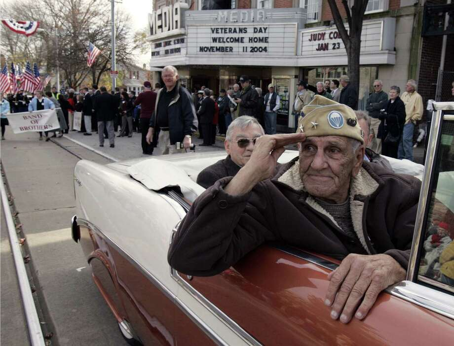 """William """"Wild Bill"""" Guarnere, saluting at a Veterans Day parade in Pennsylvania, worked behind the scenes to ensure that his """"Band of Brothers"""" comrades received the recognition they deserved. Photo: Associated Press File Photo / AP"""