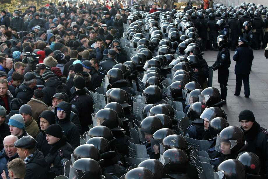 """Ukrainian riot police block the entrance of the regional administrative building during a pro Russian rally in Donetsk, Ukraine, Sunday, March 9, 2014.  Following an extraordinary meeting of the Ukrainian government, Prime Minister Arseniy Yatsenyuk announced he would be flying later this week to the United States for high-level talks on """"resolution of the situation in Ukraine,"""" the Interfax news agency reported Sunday. (AP Photo/Sergei Grits) Photo: Sergei Grits, STF / AP"""