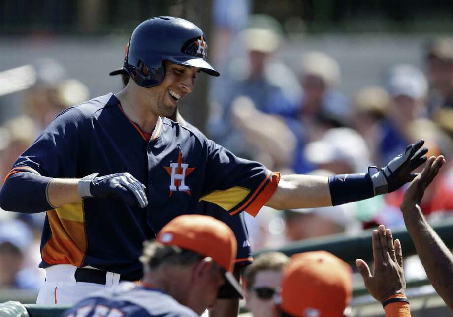Jason Castro celebrates with Houston teammates after his two-run homer helped the Astros beat the Blue Jays 4-3. Photo: Carlos Osorio / Associated Press / AP