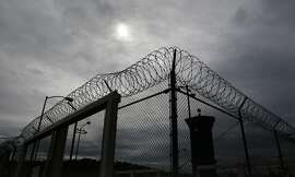Razor wire surrounds the perimeter of the California State Prison Sacramento on Wednesday March 05, 2014, in Represa, Calif. Sacramento is one of four prisons in the state that have Security Housing Units. Critics argue that the SHU's  are solitary confinement and torture.