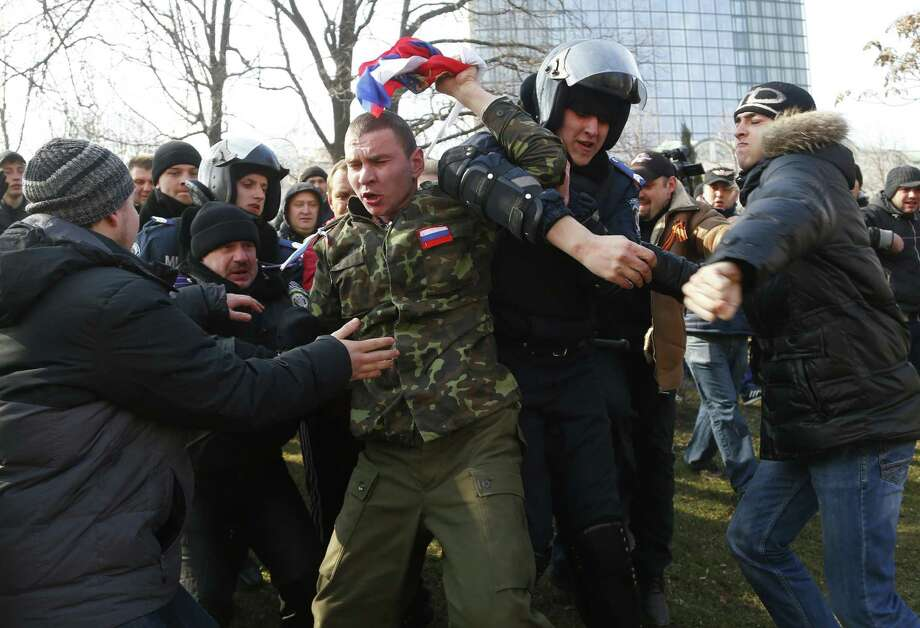 Ukrainian police struggle as they detain a demonstrator during a pro-Russian rally in Donetsk, Ukraine, on Sunday, a continuation of similar protests in recent days in the city. Photo: Sergei Grits / Associated Press / AP