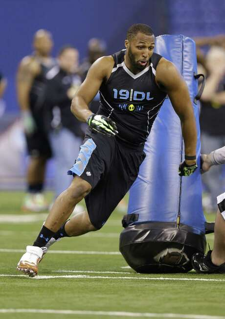 Ex-UT star Jackson Jeffcoat, running a drill at the combine, is out to prove he shouldn't be downgraded in the NFL draft. Photo: Michael Conroy / Associated Press / AP