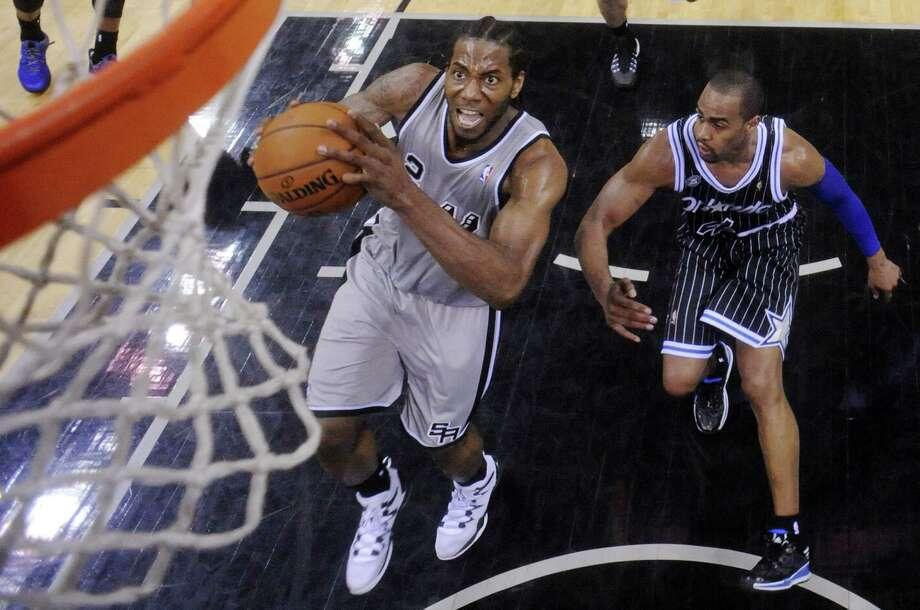 Spurs small forward Kawhi Leonard is adept on the fast break after using his 7-foot-3 wingspan to disrupt opposing offenses. Photo: Edward A. Ornelas / San Antonio Express-News / © 2014 San Antonio Express-News
