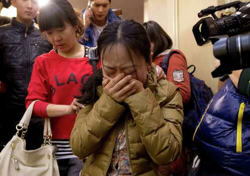 Relatives in Beijing on Sunday continue to anxiously wait for any word of the Malaysia Airlines plane that disappeared Saturday en route to China. Photo: Andy Wong, STF / AP