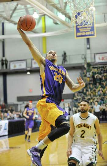 UAlbany's Gary Johnson (20) scores against Vermont during the second half of the America East Tourna