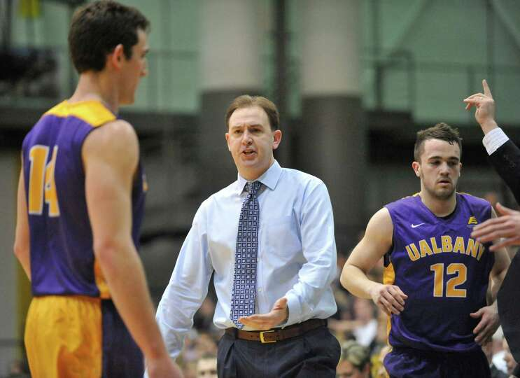 UAlbany head coach Will Brown directs his players against Vermont during the first half of the Ameri