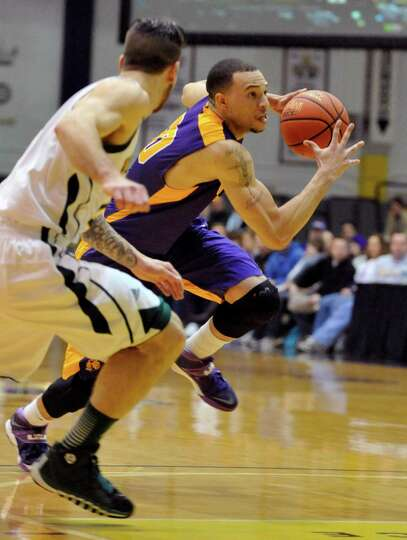 UAlbany's GarY Johnson (20) moves the ball against Vermont during the first half of the America East