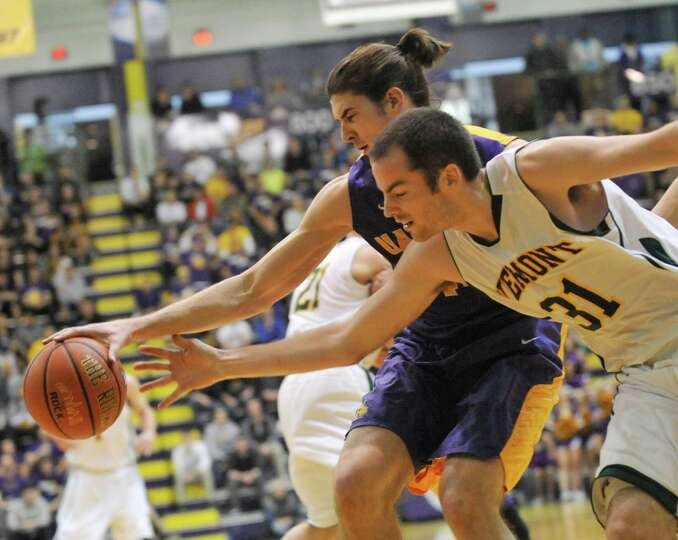 UAlbany's John Puk (44) and Vermont's Clancy Rugg (31)  battle for the ball  during the first half o