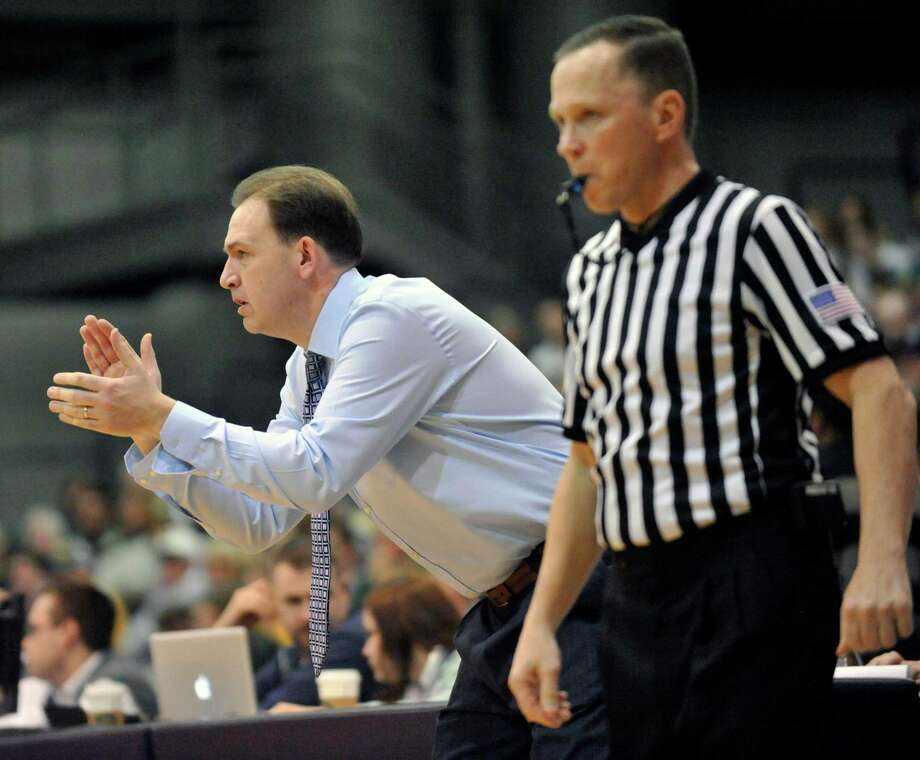 UAlbany head coach Will Brown directs his players against Vermont during the first half of the America East Tournament semifinal Men's basketball game in Albany, N.Y., Sunday, March 9, 2014.(Hans Pennink / Special to the Times Union) ORG XMIT: HP109 Photo: Hans Pennink / 00025987A