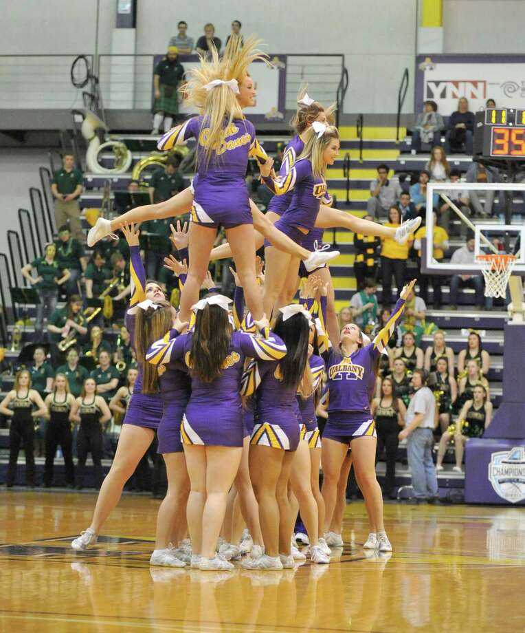 UAlbany cheerleaders perform during a game against Vermont during the second half of the America East Tournament semifinal Men's basketball game in Albany, N.Y., Sunday, March 9, 2014.(Hans Pennink / Special to the Times Union) ORG XMIT: HP117 Photo: Hans Pennink / 00025987A