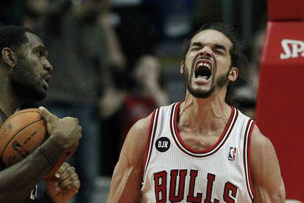 Chicago's Joakim Noah gets fired up after being fouled by Miami's Greg Oden (left) during the Bulls' 95-88 overtime win Sunday at the United Center.
