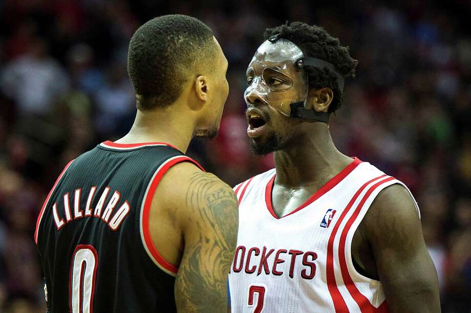 Portland's Damian Lillard, left, and the Rockets' Pat Beverley have words during the fourth quarter of a heated game in which both fouled out. Photo: Smiley N. Pool, Staff / © 2014  Houston Chronicle