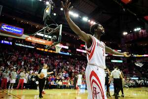 Houston Rockets point guard Patrick Beverley gestures to the crowd during the fourth quarter of an NBA basketball game against the Portland Trail Blazers at Toyota Center on Sunday, March 9, 2014, in Houston. The Rockets won the game 118-133 in overtime.